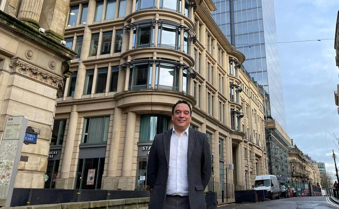 Centrick's Group Managing Director Phil Johns in front of Birmingham city centre's buildings discussing cladding