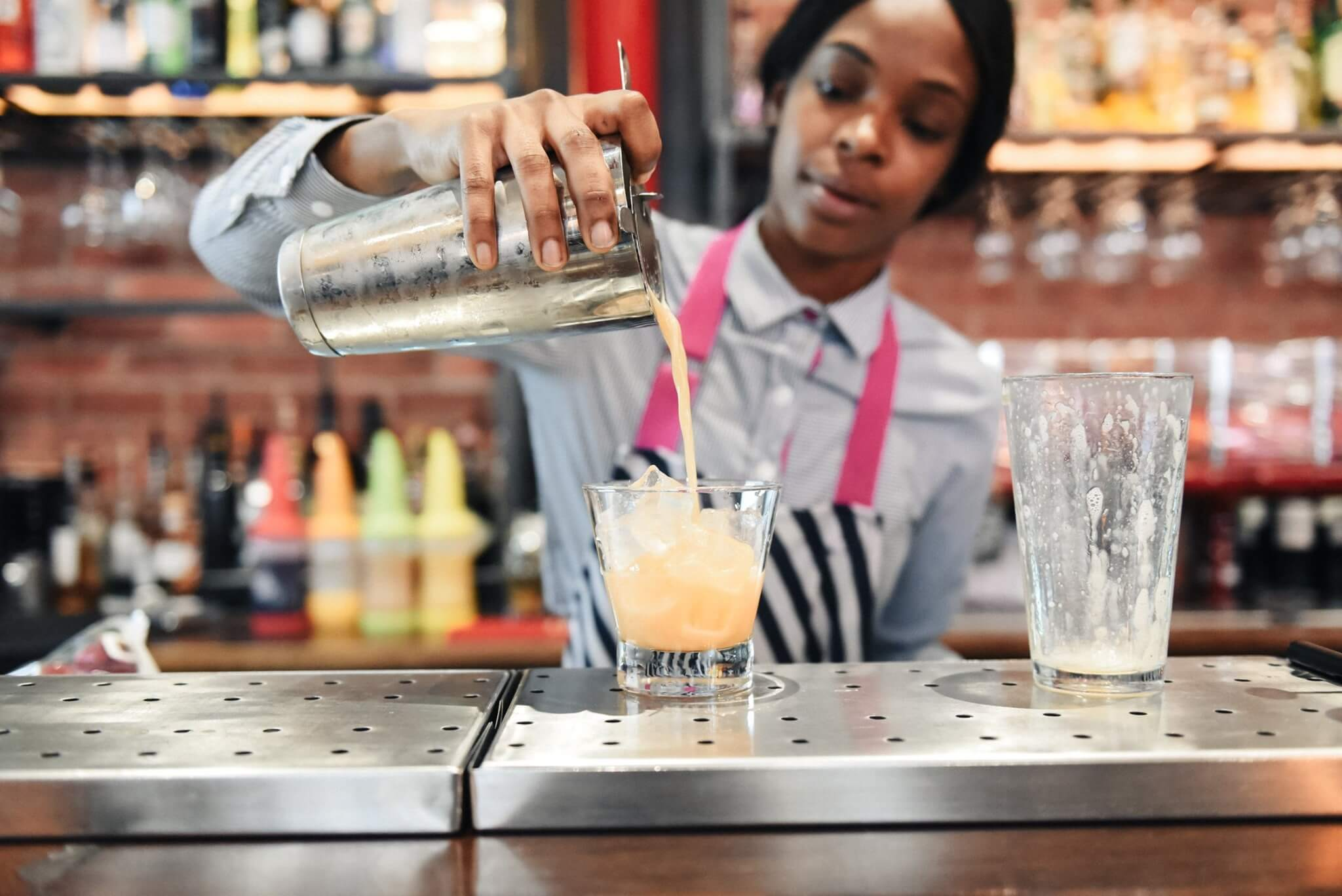 Bartender pouring a cocktail during Birmingham Cocktail Festival
